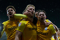 Tom Clarke of Preston North End (centre) celebrates scoring his side's winning goal during the Sky Bet Championship match between Cardiff City and Preston North End at the Cardiff City Stadium, Cardiff, Wales on 29 December 2017. Photo by Mark  Hawkins / PRiME Media Images.