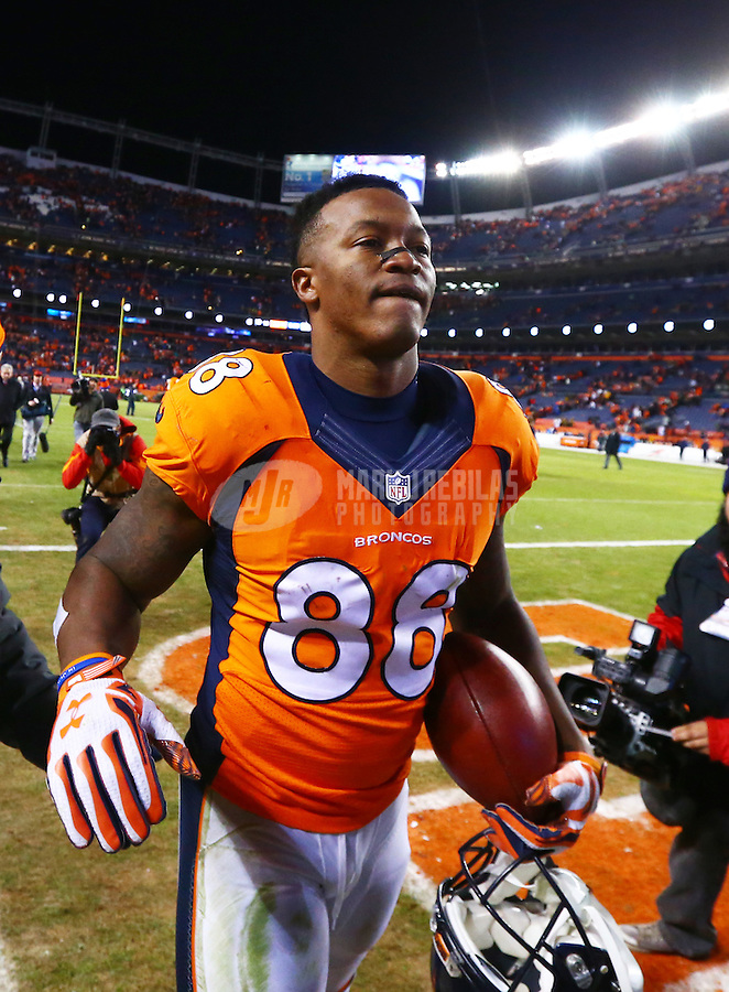 Jan 17, 2016; Denver, CO, USA; Denver Broncos wide receiver Demaryius Thomas (88) walks off the field with the game ball following the game against the Pittsburgh Steelers during the AFC Divisional round playoff game at Sports Authority Field at Mile High. Mandatory Credit: Mark J. Rebilas-USA TODAY Sports
