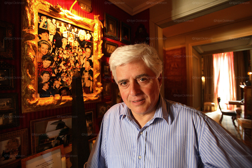 France's ostentatious interior decorator and landscape architect, self-made man Jacques Garcia in his Norman country retreat 'le Chateau du Champ de la Bataille. He is responsible for the Parisian Ladurée teahouse and Hotel  Costes. His client list includes the Sultan of Brunei. He bought the chateau, one hours drive from Paris, at le Neubourg in Normandie, twenty years ago and faced with one of the great masterpieces of French Architecture, his self appointed task was to make it more sublime. Hardly touching the facade, he re-designed the interiors to be lavish interpretations of Baroque, recalling Louis XIV and Marie Antoinette. The stylish gardens contain Roma style temples, an amphitheatre and fountains.  The chateau, open to the public, attracts 30,000 visitors per year. In 2007, with the addition of  restaurant and hotel rooms, the project will be finished.///Chateau du Champ de la Bataille interior:  Jacques Garcia with photographs  of his closest friends.