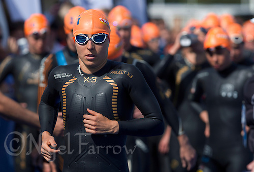 24 AUG 2013 - STOCKHOLM, SWE - Anne Haug (GER) of Germany runs to the swim pontoon for the start of the swim at the elite women's ITU 2013 World Triathlon Series round in Gamla Stan, Stockholm, Sweden (PHOTO COPYRIGHT © 2013 NIGEL FARROW, ALL RIGHTS RESERVED)