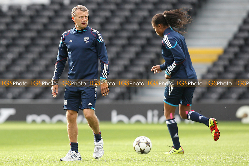Olympique Lyonnais coach Patrice Lair watches his players train on the Craven Cottage pitch ahead of the UEFA Women's Champions League Final at Fulham FC - 25/05/11 - MANDATORY CREDIT: Gavin Ellis/TGSPHOTO - Self billing applies where appropriate - Tel: 0845 094 6026