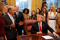 "United States Secretary of Commerce Wilbur L. Ross, Jr. makes remarks prior to US President Donald J. Trump signing the National Security Presidential Memorandum to Launch the ""Women's Global Development and Prosperity"" Initiative in the Oval Office of the White House in Washington, DC on Thursday, February 7, 2019.  At far right is First Daughter and Advisor to the President Ivanka Trump.<br /> Credit: Martin H. Simon / CNP/AdMedia"