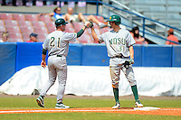North Dakota State Bison head coach Tod Brown (21) and first baseman Wes Satzinger (31) during a game against the Bowling Green Falcons at Chain of Lakes Stadium on March 9, 2013 in Winter Haven, Florida.  NDSU defeated Bowling Green 8-5.  (Mike Janes/Four Seam Images)