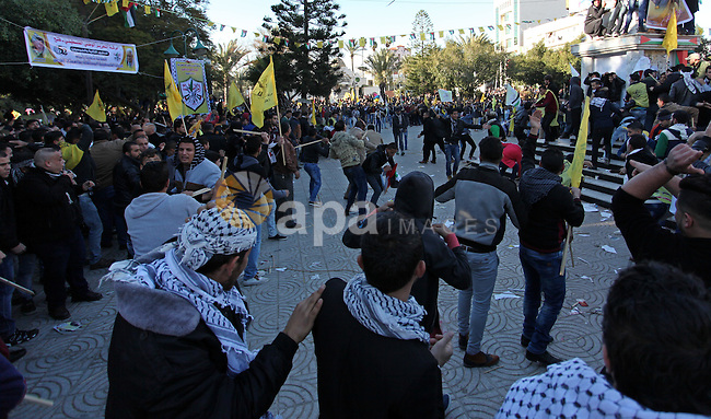 Supporters of the Palestinian president clash with supporters (background) of Mohammed Dahlan, an exiled rival to Mahmud Abbas who was recently sentenced in absentia to three years in prison on corruption charges, during a rally in Gaza City on December 31, 2016, marking the 52nd anniversary of the creation of the Fatah movement. Photo by Ashraf Amra