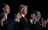 United States President Donald Trump (C) applauds at the National Prayer Breakfast February 2, 2017 in Washington, DC. Every U.S. president since Dwight Eisenhower has addressed the annual event. Also pictured (L-R) are television producer Mark Burnett, and Sen. John Boozman (R-AR).  <br /> Credit: Win McNamee / Pool via CNP