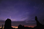 Balanced Rock in Arches National Park at Dawn with the Orion Constellation.