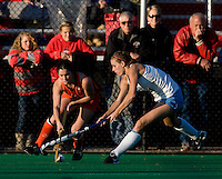 Meghan Dawson (21) of UNC tries to take the ball away from Michelle Vittese (9) of Virginia during the NCAA Field Hockey Championship semfinals in College Park, MD.  North Carolina defeated Virginia, 4-3, in overtime.
