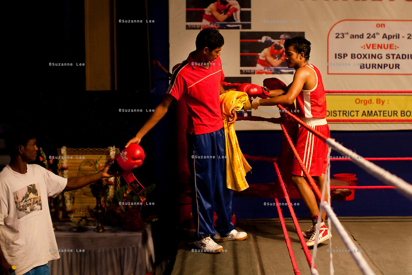 Boxers at the red corner at an all-India invitational boxing competition in the neighbouring town of Burnpur, Calcutta, West Bengal, India. Razia Shabnam, 28, was one of the first women boxers in Kolkata. She was also the first woman in her community to go to college. She is now a coach and one of only three international female boxing referees in India. Photo by Suzanne Lee for Panos London