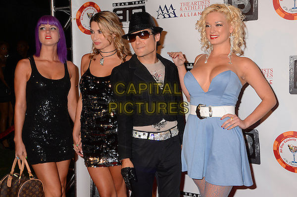 Corey Feldman &amp; guests<br /> 8th Annual BTE All-Star Celebrity Kick-Off Party at Playboy Mansion in Los Angeles, CA., USA.<br /> July 15th, 2013<br /> half length black blue dress hat sunglasses shades sequin cleavage<br /> CAP/ADM/BT<br /> &copy;Birdie Thompson/AdMedia/Capital Pictures