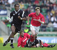 25/05/2002 (Saturday).Sport -Rugby Union - London Sevens.Wales vs New Zealand.Joe Rokocoko, NZL chaseed by Arwel Thomas[Mandatory Credit, Peter Spurier/ Intersport Images].