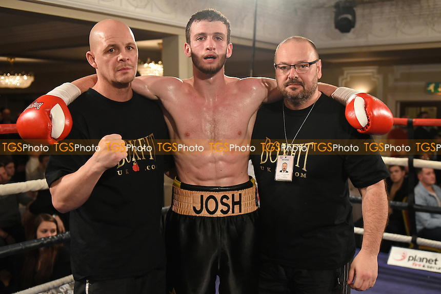 Josh Burnham (C)  with Jason Rowland (L) and Richard Clark after defeating Rob Brown during a Boxing show at the Prince Regent Hotel, Chigwell, Essex