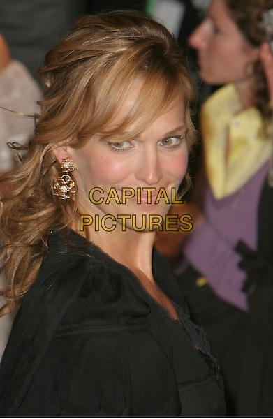 MOLLY SIMS.2006 Vanity Fair Oscar Party held at Morton's, West Hollywood, California, USA.March 5th, 2006.Photo: Charles Harris/AdMedia/Capital Pictures.Ref: CH/ADM.headshot portrait black gold earrings.www.capitalpictures.com.sales@capitalpictures.com.© Capital Pictures.
