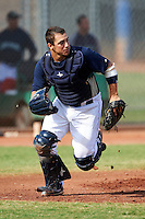 Seattle Mariners minor league catcher Luke Guarnaccia #14 during an instructional league game against the San Diego Padres at the Peoria Sports Complex on October 6, 2012 in Peoria, Arizona.  (Mike Janes/Four Seam Images)