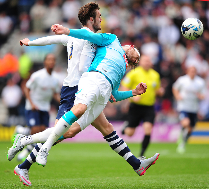 Preston North End's Will Keane vies for possession with Derby County's Richard Keogh<br /> <br /> Photographer Chris Vaughan/CameraSport<br /> <br /> Football - The Football League Sky Bet Championship - Preston North End v Derby County - Saturday 12th September 2015 -  Deepdale - Preston<br /> <br /> &copy; CameraSport - 43 Linden Ave. Countesthorpe. Leicester. England. LE8 5PG - Tel: +44 (0) 116 277 4147 - admin@camerasport.com - www.camerasport.com