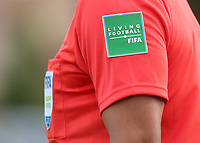 The assistant referee wore a message on his sleeve with the words, Living Football FIFA during France Under-18 vs Brazil Under-20, Tournoi Maurice Revello Football at Stade d'Honneur Marcel Roustan on 5th June 2019