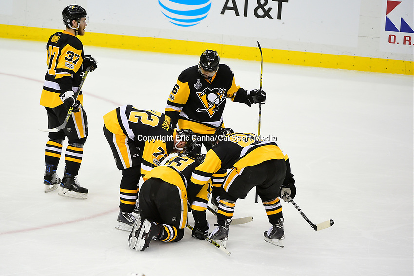 May 31, 2017: Pittsburgh Penguins right wing Phil Kessel (81) and right wing Patric Hornqvist (72) help center Nick Bonino (13) to his feet during game two of the National Hockey League Stanley Cup Finals between the Nashville Predators  and the Pittsburgh Penguins, held at PPG Paints Arena, in Pittsburgh, PA. The Penguins defeat the Predators 4-1 and lead the series 2-0. Eric Canha/CSM