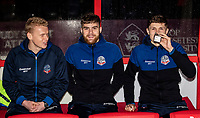 Bolton Wanderers' (l-r): James Weir, Sonny Graham and Adam Senior take shelter before the match<br /> <br /> Photographer Andrew Kearns/CameraSport<br /> <br /> The EFL Sky Bet League One - Lincoln City v Bolton Wanderers - Tuesday 14th January 2020  - LNER Stadium - Lincoln<br /> <br /> World Copyright © 2020 CameraSport. All rights reserved. 43 Linden Ave. Countesthorpe. Leicester. England. LE8 5PG - Tel: +44 (0) 116 277 4147 - admin@camerasport.com - www.camerasport.com