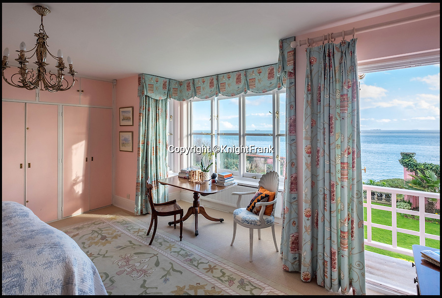 """BNPS.co.uk (01202 558833)<br /> Pic: KnightFrank/BNPS<br /> <br /> One of the bedrooms.<br /> <br /> This quaint beach hut is the perfect spot for those dreaming of living by the sea - and you also get a seven-bedroom house for the £2.24million price tag.<br /> <br /> Ledge House on the Isle of Wight is one of very few properties on the island that has direct access to the beach and the house and gardens take full advantage of the breathtaking views.<br /> <br /> While the house itself is impressive, with more than 4,000 sq ft of living space and beautiful gardens, the Boat House and Beach Hut set down by the beach are the real selling point. <br /> <br /> Owner Georgie Donnelly described them as being like """"another world"""", completely secluded from the main house and above prying eyes from the beach."""
