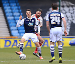 Millwall's Lee Gregory tussles with Sheffield United's David Edgar during the League One match at The Den.  Photo credit should read: David Klein/Sportimage