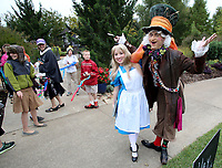 NWA Democrat-Gazette/DAVID GOTTSCHALK  Alice, portrayed by Heather Hodge, and Mad Hatter, portrayed by Ty Volz, both with Spotlight Characters, enter Tuesday, October 10, 2017 the Botanical Garden of the Ozarks in Fayetteville during the Garden's 10 Birthday Party. The party included free entry, crafts, entertainment and ten percent off memberships.
