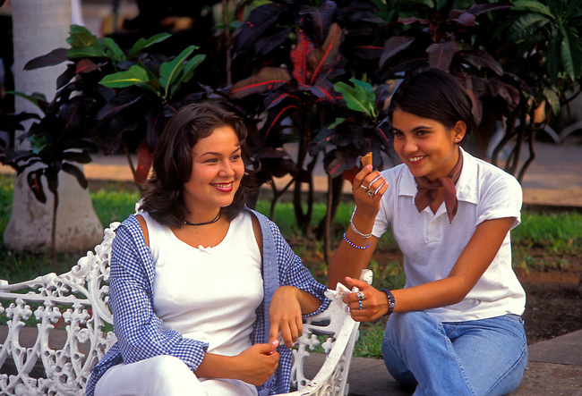 Two female students sitting in the Plaza Principal in Puerto Vallarta, Jalisco State, Mexico, North America