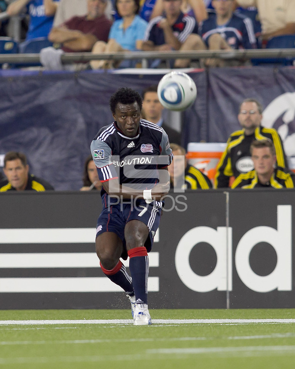 New England Revolution forward Kenny Mansally (7) crosses the ball. The New England Revolution tied Columbus Crew, 2-2, at Gillette Stadium on September 25, 2010.