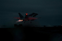 101215-N-7981E-572 PACIFIC OCEAN (Dec. 15, 2010)- An F/A-18C Hornet assigned to Strike Fighter Squadron 113 launches from the flight deck of USS Carl Vinson (CVN 70) after sunset. Carl Vinson and Carrier Air Wing (CVW) 17 are currently on a three-week composite training unit exercise (COMPTUEX) followed by a western Pacific deployment. (U.S. Navy photo by Mass Communication Specialist 2nd Class James R. Evans / RELEASED)