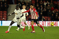 Pictured L-R: Bafetimbi Gomis of Swansea against Maya Yoshida of Southampton Sunday 01 February 2015<br />