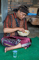 Bali, Indonesia.  Balinese Hindu Man Eating Rice.  He is wearing the udeng, the traditional Balinese head cloth.