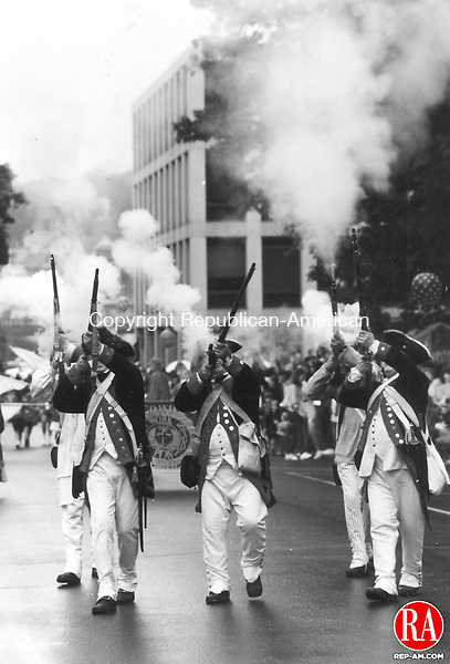 May 30, 1995 - NAUGATUCK - Captain Stephen Buckland and the Company of Artillery fire their guns during the Memorial Day Parade in Naugutuck. Republican-American Archives