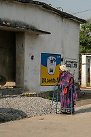 An old woman walks through the neighbourhood in Ambedkar Nagar in Medak, Telangana, India.