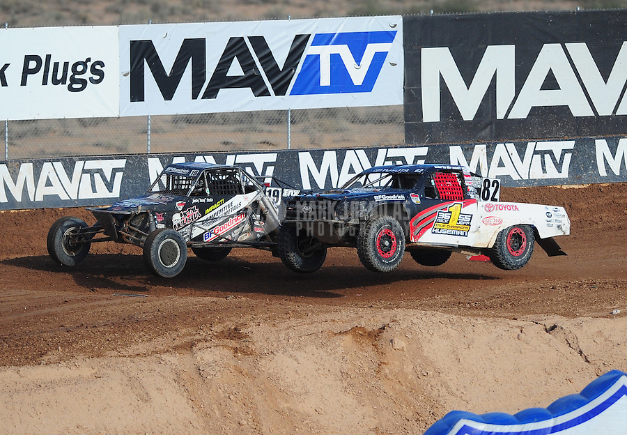 Dec. 11, 2011; Chandler, AZ, USA;  LOORRS pro buggy driver Justin Smith (19) and pro lite driver Chris Brandt (82) during the Lucas Oil Challenge Cup at Firebird International Raceway. Mandatory Credit: Mark J. Rebilas-