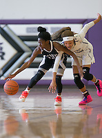 Maverick Jade Jeffries and Cedar Ridge's Imani Robinson battle for the ball Saturday at Cedar Ridge.  The Lady Raiders won 84-39.  (LOURDES M SHOAF for Round Rock Leader.)