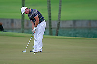 Damien McGrane (IRL) takes his putt on the 16th green during Friday's Round 2 of the 2011 Barclays Singapore Open, Singapore, 11th November 2011 (Photo Eoin Clarke/www.golffile.ie)