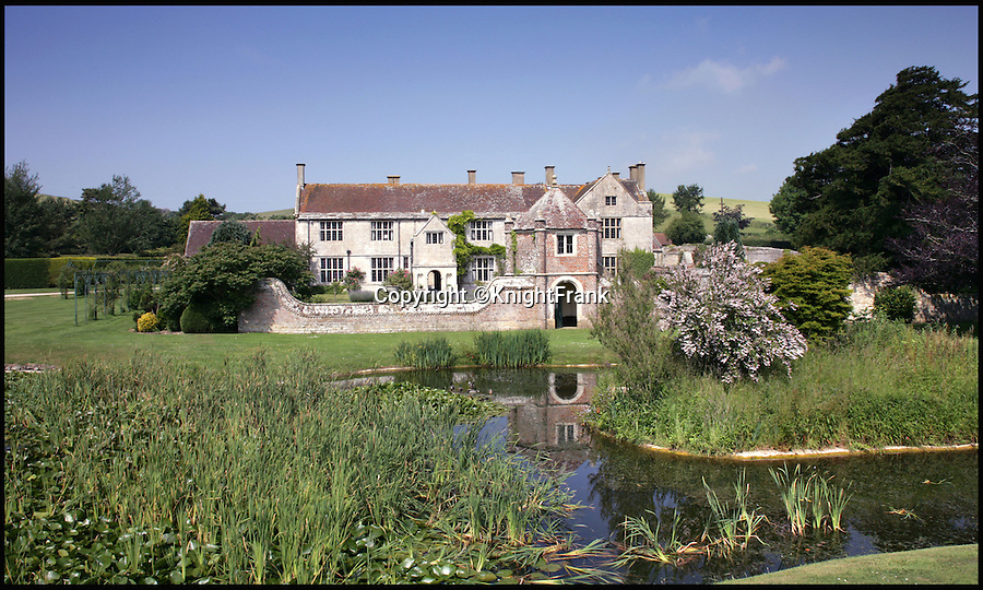 BNPS.co.uk (01202 558833)<br /> Pic: KnightFrank/BNPS<br /> <br /> This stunning manor house looks like something straight out of a Thomas Hardy novel... and that's because it is. <br /> <br /> Historic Poxwell Manor, which was used by Hardy in The Trumpet-Major as the main residence of the story's heroine, is now on the market for £3.25million.<br /> <br /> The Grade I listed house, near Hardy's hometown of Dorchester in Dorset, comes with 10 acres of land, a three-bedroom cottage and a range of traditional barns