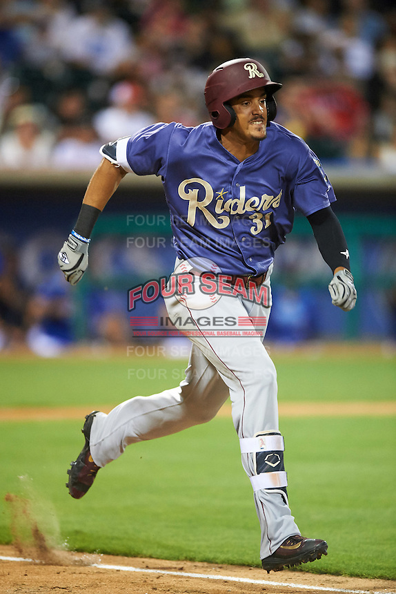 Frisco RoughRiders first baseman Ronald Guzman (31) runs to first during a game against the Corpus Christi Hooks on April 23, 2016 at Whataburger Field in Corpus Christi, Texas.  Corpus Christi defeated Frisco 3-2.  (Mike Janes/Four Seam Images)