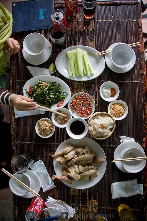 Lunch in a roadside restaurant near So village, south-west of Hanoi, Vietnam. (From the book What I Eat: Around the World in 80 Diets.)