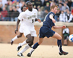 02 December 2007: Wake Forest's Marcus Tracy (9) and West Virginia's Andrew Halsell (17). The Wake Forest University Demon Deacons defeated the West Virginia University Mountaineers 3-1 at W. Dennie Spry Soccer Stadium in Winston-Salem, North Carolina in a Third Round NCAA Division I Mens Soccer Tournament game.