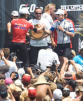 First place winner American and Huntington Beach local Brett Simpson (red singlet) and Australian runner up Mick Fanning (white singlet) congratulate each on the podium. 2009 WQS 6 Star US Open of Surfing in Huntington Beach, California on Sunday July 26, 2009. ..
