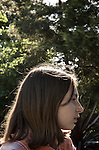 Young girls face in profile outdoors in summer