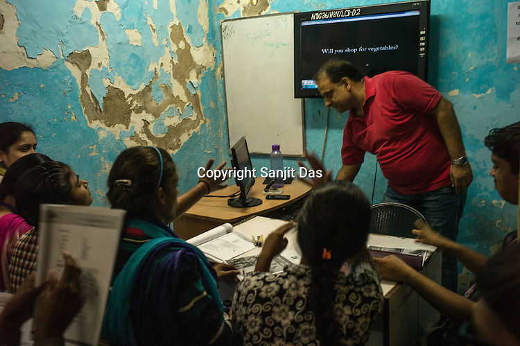 Deaf students pay the attention to the tutor during a lesson in a classroom at the Noida Deaf Society in Noida, Uttar Pradesh, India.