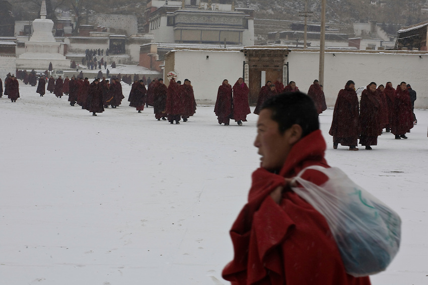 Monks of the monastery of Labrang are leaving the Great Assembly Hall after the morning ceremony. After the riots of march 2008, more than 150 of them have been detained, four are still waiting for their trial.