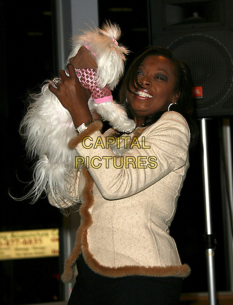 "STAR JONES REYNOLDS.Star Jones Reynolds book signing of ""SHINE"" held at Borders, Westwood, California, USA,.24 February 2006..half length holding dog Pinky pet animal booksigning.Ref: ADM/ZL.www.capitalpictures.com.sales@capitalpictures.com.©Zach Lipp/AdMedia/Capital Pictures."