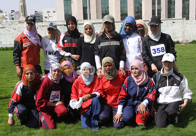 Palestinian women compete in different sports during a local athletics competition at Palestine Stadium in Gaza City on May 8, 2010. Photo by Mohammed Asad