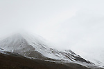 Mist over snow-covered peak, Sarychat-Ertash Strict Nature Reserve, Tien Shan Mountains, eastern Kyrgyzstan