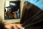 Amanda Daponde, works on her hair in the mirror as classmate Tim Eckel looks on, prior to the Erico Fermi graduation ceremony, Friday,  Jun2 23, 2011, at the high school in Enfield. (Jim Michaud/Journal Inquirer)