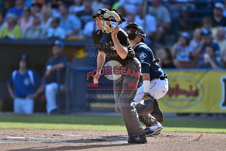 Home plate umpire Kyle Wallace during a game between the Charleston RiverDogs and the Asheville Tourists due to an injury earlier in the week to his crewmate  on June 13, 2015 in Asheville, North Carolina. The Tourists defeated the RiverDogs 10-6. (Tony Farlow/Four Seam Images)