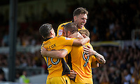 Jonathan Parkin of Newport County (9) celebrates scoring his side's first goal with Reece Grego-Cox and Mark Randall during the Sky Bet League 2 match between Newport County and Cheltenham Town at Rodney Parade, Newport, Wales on 10 September 2016. Photo by Mark  Hawkins / PRiME Media Images.