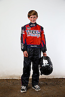 Mar. 21, 2014; Chandler, AZ, USA; LOORRS modified kart driver Parker Steele poses for a portrait prior to round one at Wild Horse Motorsports Park. Mandatory Credit: Mark J. Rebilas-USA TODAY Sports