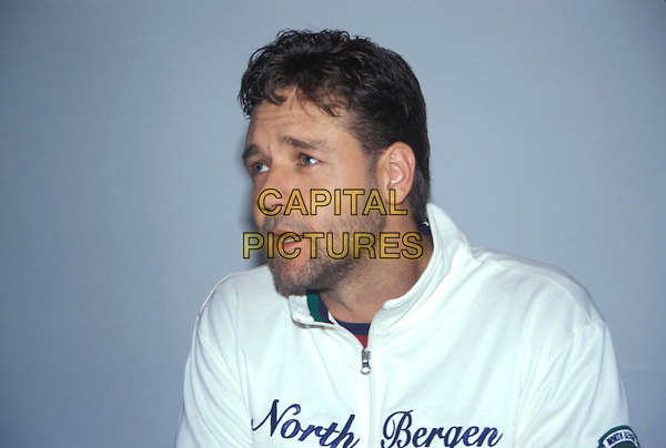"RUSSELL CROWE.July 2005.headshot portrait ""North Bergen"" white top zip up stubble facial hair .www.capitalpictures.com.sales@capitalpictures.com.© Capital Pictures."